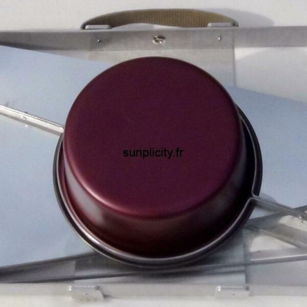 Détail de la fixation du récipient sur le four sunplicity replié