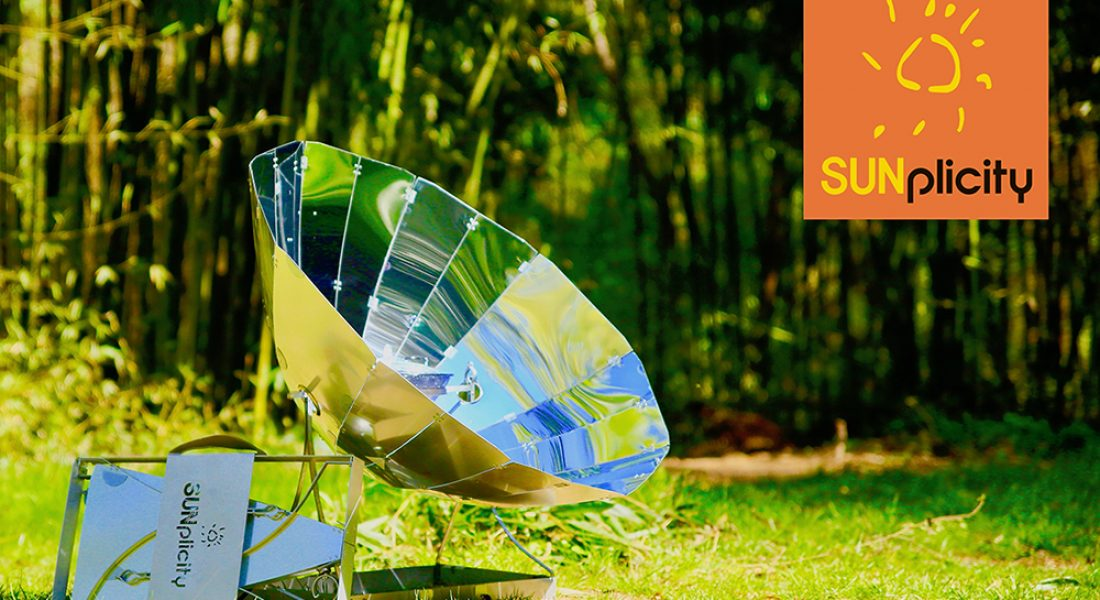 The SUNplicity foldable solar cooker in a bamboo forest